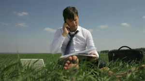 stock-footage-handsome-man-doing-business-over-the-phone-from-his-new-workplace-in-the-countryside-and-relaxing